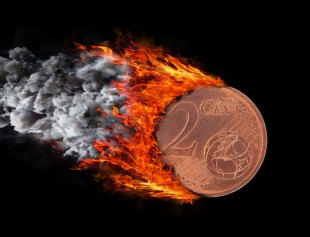 Burning coin with a trail of fire and smoke - 2 eurocent